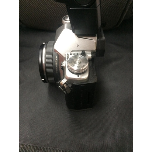 421 - AN OLYMPUS OM-D ES MK11 CAMERA WITH PANASONIC LUMIX 14MM LENS, TWO BATTERIES, FLASH, CHARGER AND BAG...