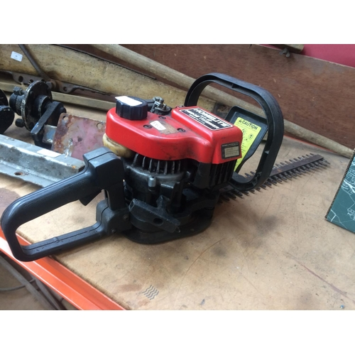 43 - A BLACK AND RED HOMELITE MODEL HT17 PETROL HEDGE TRIMMER WITH 16