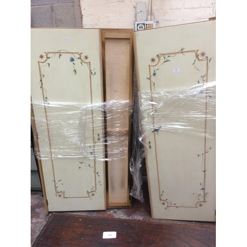 433 - A PAINTED DOUBLE WARDROBE...