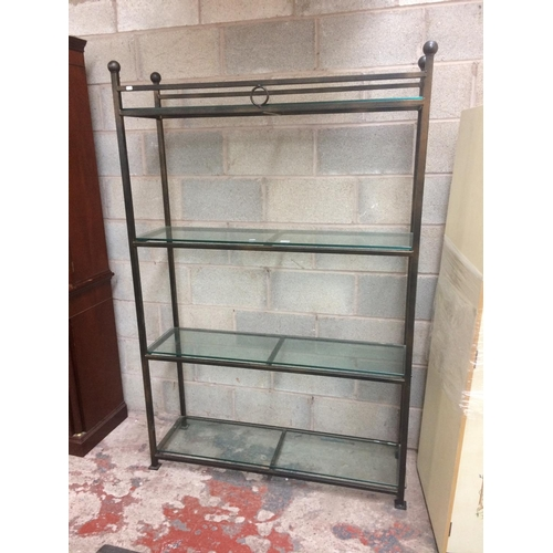 434 - A WROUGHT IRON DISPLAY SHELF WITH FOUR GLASS INSERTS...
