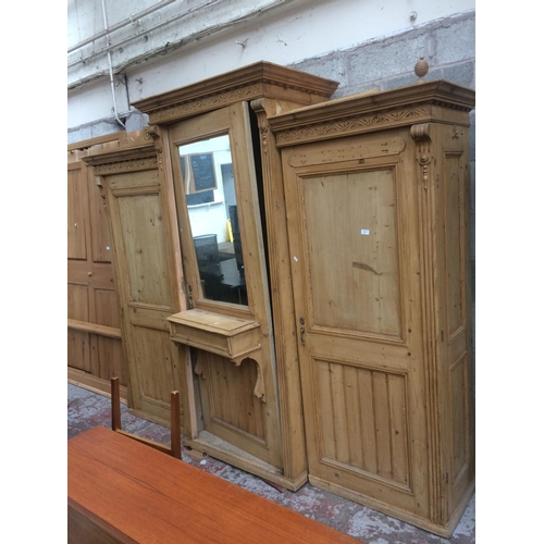 438 - A LARGE VINTAGE PINE TRIPLE WARDROBE WITH CENTRE MIRROR...