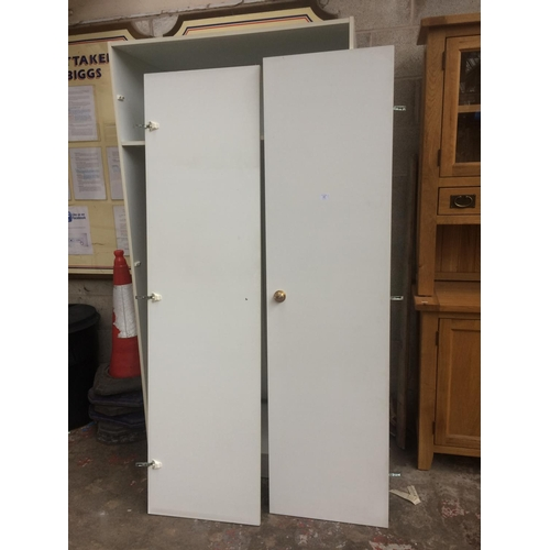 439 - A MODERN WHITE LAMINATE DOUBLE WARDROBE...