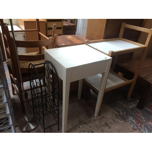 443 - TWO ITEMS TO INCLUDE A SMALL WHITE SIDE TABLE AND A WHITE LAMINATE TEA TROLLEY...