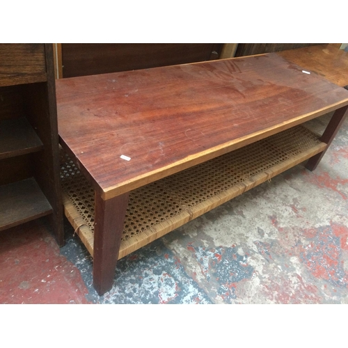 446 - A LARGE MAHOGANY COFFEE TABLE WITH RATTAN BASE...