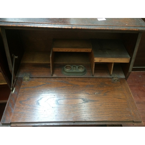 447 - TWO ITEMS TO INCLUDE A MAHOGANY EFFECT BOOKCASE AND A VINTAGE OAK BUREAU WITH ONE DRAWER AND FALL FR...