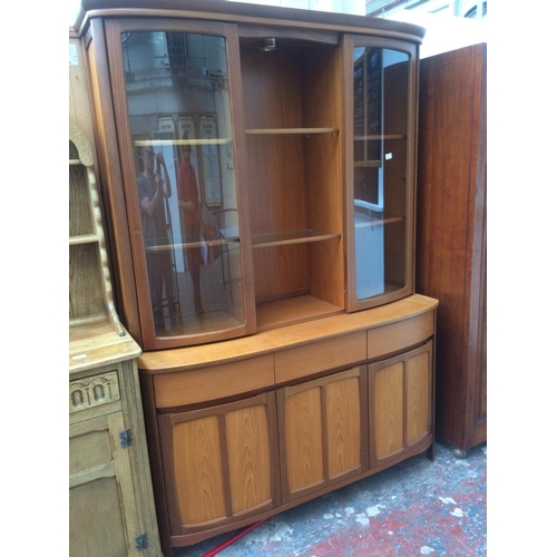477 - A NATHAN TEAK DRESSER WITH THREE LOWER DOORS, THREE DRAWERS AND TWO UPPER GLAZED DOORS...
