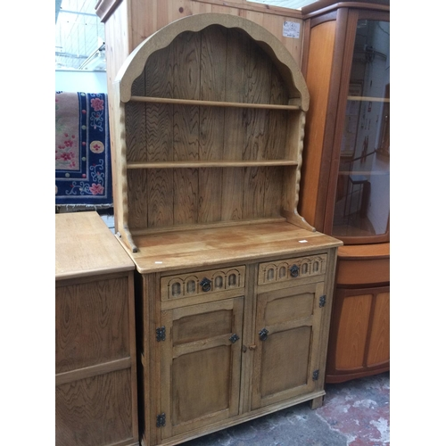 478 - AN OAK DRESSER WITH TWO DRAWERS, TWO DOORS AND UPPER PLATE RACK...