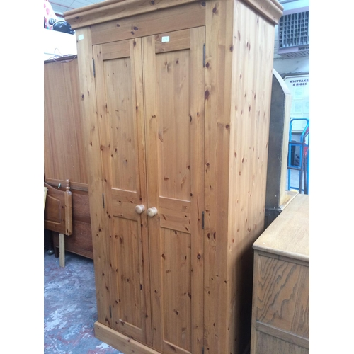 479A - A GOOD QUALITY SOLID PINE DOUBLE WARDROBE...