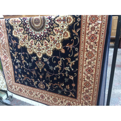 485 - A BLUE GROUND KESHAN CARPET MEASURING 2.3 X 1.6 METRES...