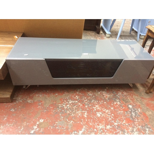 499 - A MODERN GREY GLOSS TV STAND WITH SINGLE DOOR...