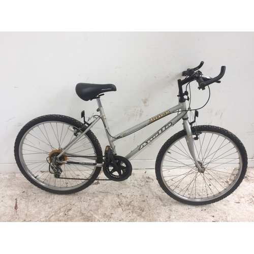 5 - A SILVER APOLLO JUICE LADIES MOUNTAIN BIKE WITH 10 SPEED SHIMANO GEAR SYSTEM...