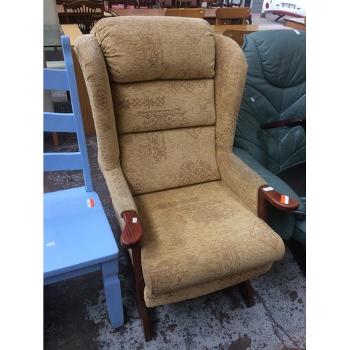 505 - A BEIGE WINGBACK ROCKING CHAIR...