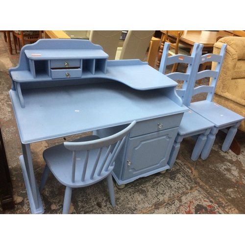 506 - A BLUE PAINTED DESK WITH TWO MATCHING LADDER BACK CHAIRS AND ONE MATCHING STICK BACK CHAIR...