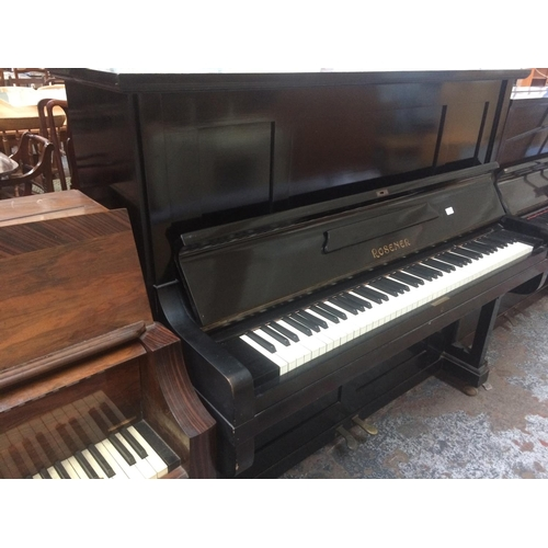 508 - A ROSENER X-STRUNG BLACK LACQUERED UPRIGHT PIANO...