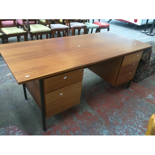 516 - A TEAK EFFECT OFFICE DESK WITH FIVE DRAWERS (KEYS IN OFFICE)...