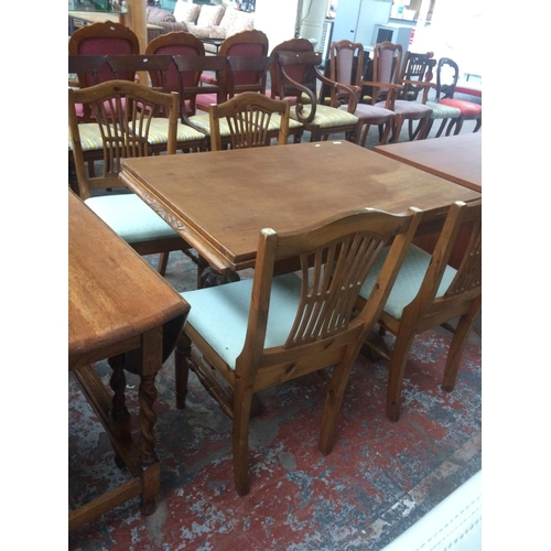 517 - A VINTAGE OAK DINING TABLE AND FOUR PINE DINING CHAIRS...