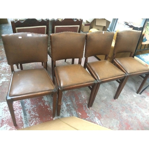 522 - FOUR 1950'S BROWN LEATHERETTE DINING CHAIRS...