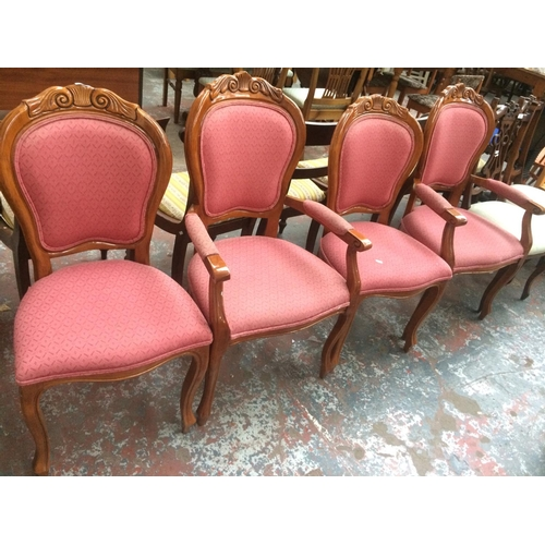 532 - A SET OF FOUR MAHOGANY DINING CHAIRS WITH PINK UPHOLSTERY INCLUDING TWO CARVERS...