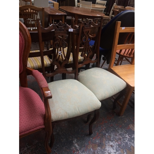 533 - A PAIR OF ORNATE CARVED MAHOGANY DINING CHAIRS...