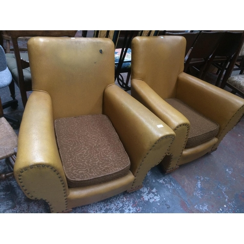 537 - A PAIR OF 1950'S YELLOW LEATHERETTE ARM CHAIRS...