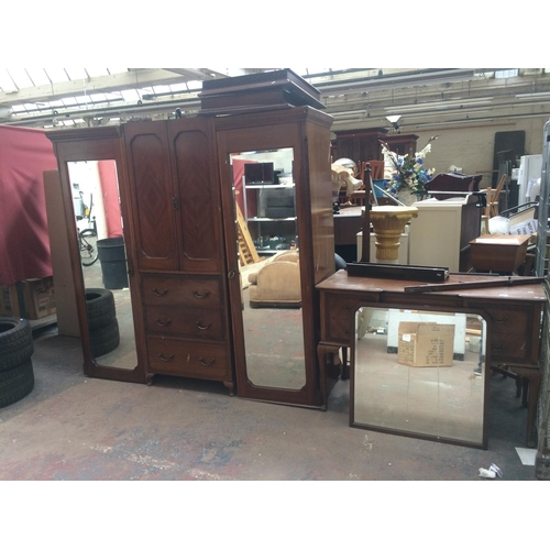 555 - A VINTAGE MAHOGANY TRIPLE WARDROBE WITH TWO BEVEL EDGE MIRRORS, THREE DRAWERS AND TWO DOORS TOGETHER...