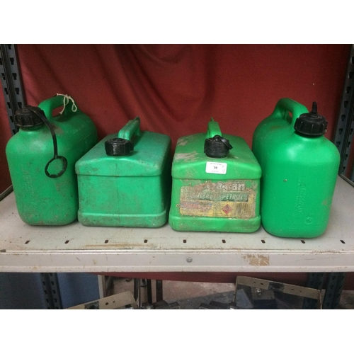 59 - FOUR GREEN PLASTIC UNLEADED PETROL CANS...