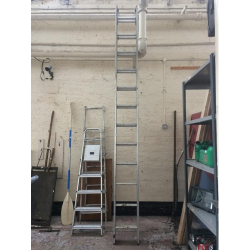 63 - A SET OF DOUBLE EXTENDABLE 24 RUNG ALUMINIUM WORK LADDERS...