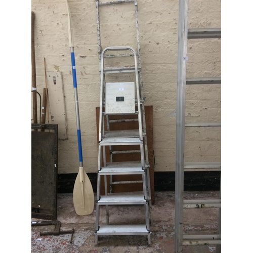 64 - THREE ITEMS TO INCLUDE A FIVE STEP ALUMINIUM STEP LADDER, WOODEN DECORATORS TABLE AND A MULTI PURPOS...