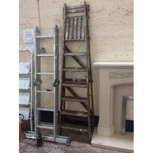 68 - A SET OF SEVEN STEP WOODEN STEP LADDERS...