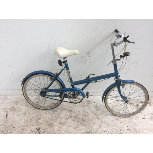 7 - A VINTAGE BLUE TRIUMPH FOLDING LADIES' SHOPPING BIKE WITH FRONT AND REAR LIGHTS AND 3 SPEED GEAR SYS...