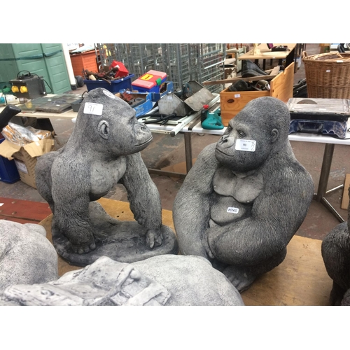 91 - TWO GOOD QUALITY RECONSTITUTED STONE GORILLA GARDEN ORNAMENTS -  ONE WALKING AND ONE SITTING...