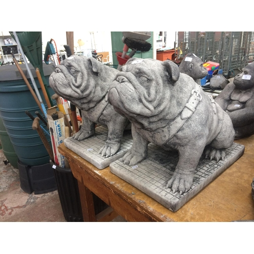 92 - TWO GOOD QUALITY RECONSTITUTED STONE BRITISH BULLDOG GARDEN ORNAMENTS ON PLINTHS...