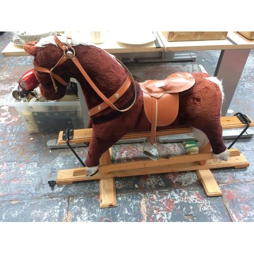 357 - A PINE FRAMED CHILD'S ROCKING HORSE...