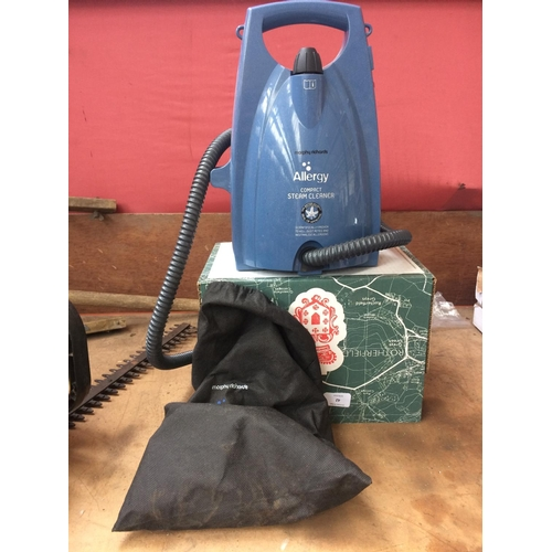 42 - A BOX CONTAINING A MORPHY RICHARDS COMPACT STEAM CLEANER WITH HOSE AND ATTACHMENTS...