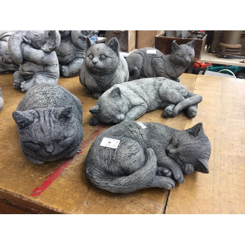 86 - FIVE GOOD QUALITY RECONSTITUTED STONE CAT GARDEN ORNAMENTS...