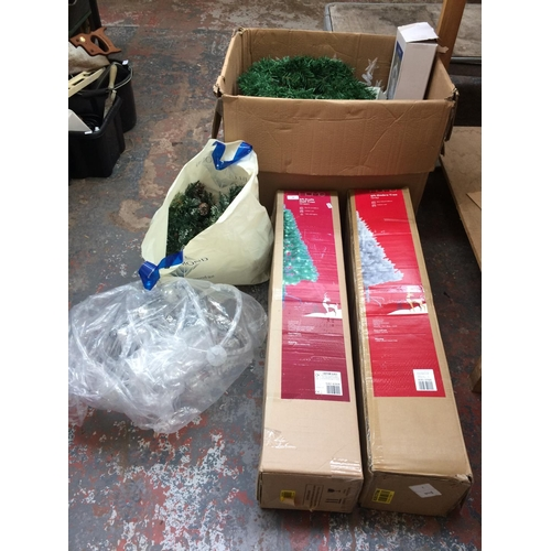 99 - A LARGE QUANTITY OF CHRISTMAS ITEMS TO INCLUDE BOXED ARTIFICIAL CHRISTMAS TREES, LIGHTS ETC...