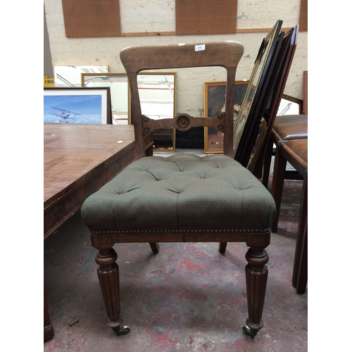 524 - AN ANTIQUE GILLOWS OF LANCASTER OAK FRAMED GREEN UPHOLSTERED CHAIR ON REEDED SUPPORTS...
