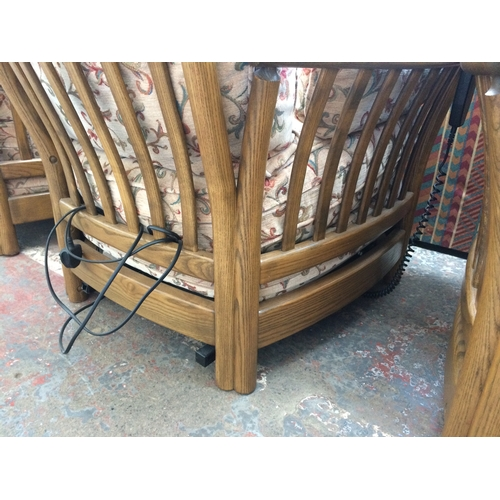 545 - AN ERCOL RENAISSANCE ELM THREE PIECE LOUNGE SUITE COMPRISING OF TWO SEATER SOFA AND TWO ARMCHAIRS (O...