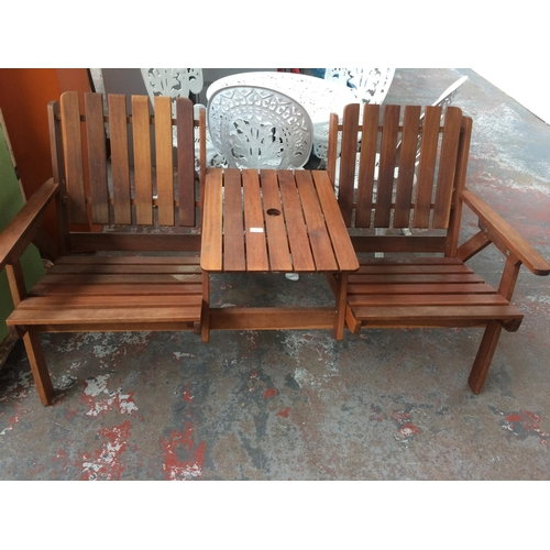 30 - A GOOD QUALITY TEAK WOOD TWO SEAT GARDEN BENCH WITH CENTRAL TABLE...
