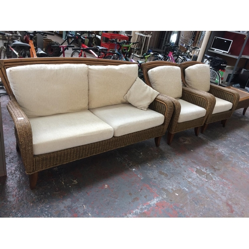 38 - A GOOD QUALITY BAMBOO AND WICKER CONSERVATORY SET COMPRISING THREE SEATER SOFA, TWO ARMCHAIRS AND MA...