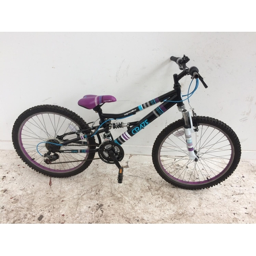 7 - A BLACK APOLLO CRAZE DUAL SUSPENSION BOYS STUNT BIKE WITH 18 SPEED SHIMANO GEAR SYSTEM...