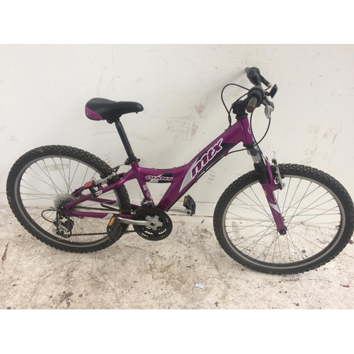 2 - A PURPLE GIANT MTX BOYS MOUNTAIN BIKE WITH FRONT SUSPENSION AND 18 SPEED SHIMANO GEAR SYSTEM...