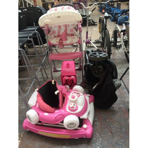 41 - FOUR CHILD'S ITEMS TO INCLUDE A BLACK BRITAX B-AGILE PUSHCHAIR, A PINK TRAVEL COT, A PINK AND WHITE ...