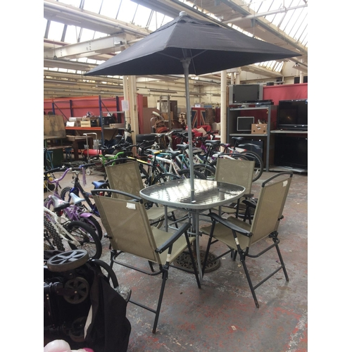 42 - A SEVEN PIECE PATIO SET COMPRISING GLASS TOPPED GREY METAL SQUARE TABLE, FOUR FOLDING CHAIRS AND A P...