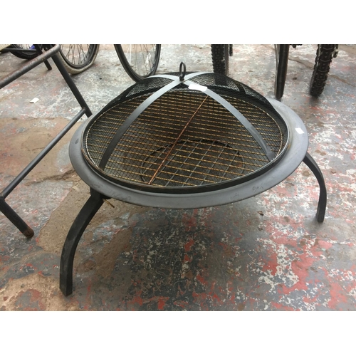 43 - A LOWE LEVEL FIRE PIT WITH GUARD...