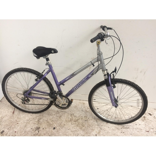 6 - A PURPLE AND GREY GIANT SEDONA LADIES MOUNTAIN BIKE WITH FRONT SUSPENSION, QUICK RELEASE FRONT WHEEL...
