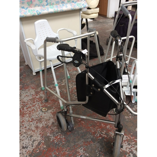16 - THREE ITEMS OF MOBILITY EQUIPMENT TO INCLUDE ALUMINIUM WALKING AID, SHOWER CHAIR AND DAYS THREE WHEE...