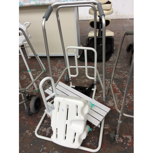 17 - FIVE ITEMS OF MOBILITY EQUIPMENT TO INCLUDE COOPERS ALUMINIUM WALKING AID, A BATH BOARD, BATH HANDLE...