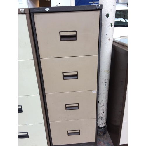 22 - A BROWN AND BEIGE TRIUMPH FOUR DRAWER OFFICE FILING CABINET...