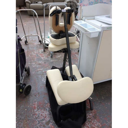30 - A BAGGED TAHITI FOLDING MASSAGE CHAIR IN GOOD CLEAN CONDITION...